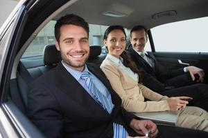Business team working in the back seat