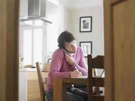 Man Using Phone In Kitchen