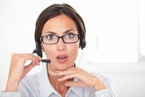 Professional employee speaking on the headphones