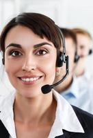 Three call center service operators at work