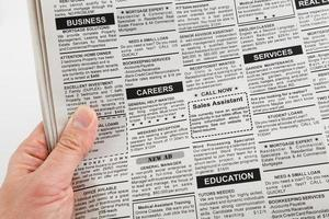 Newspaper page with classified adverts on