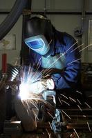 Welding a car chassis photo