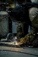 Employee welding in company