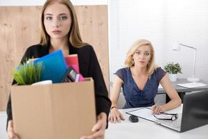 Boss dismissing an employee. Getting fired concept. photo