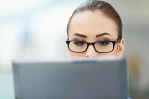Office worker closely looks into the monitor photo