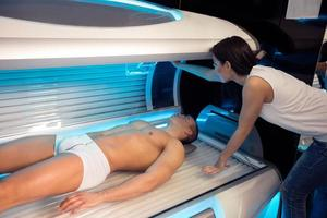 girl employee in a solarium with customer