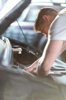 Automobile mechanic repairing a car