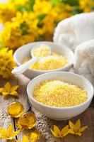 spa with yellow herbal bath pearls and flowers photo
