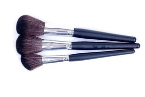 makeup brushes on an isolated background