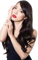 Beautiful Asian woman with red lips on isolated background