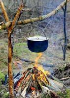 tourist kettle on campfire photo