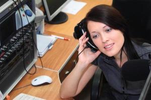 Radio DJ in the broadcasting studio photo