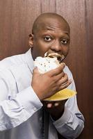 Businessman eating cake photo
