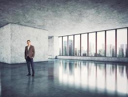 Businessman standing in modern bright office