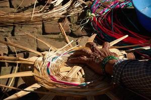 Woman makes basket