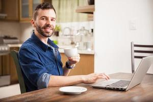 Happy man working from home photo