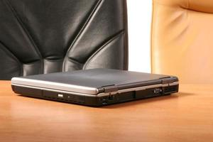 Laptop on the desk photo
