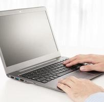 man hands busy using laptop