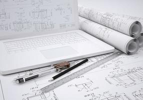 Scrolls engineering drawings and laptop