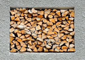 abstract background with stacked firewood in the wall