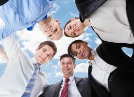 Business people of multiethnic backgrounds forming a huddle