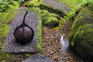 Traditional japanese weight in zen garden photo