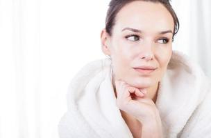 Thoughtful woman after treatments in spa photo
