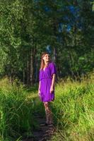Pretty woman on a field photo