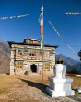 Buddhist monastery or gompa in Kharikhola village with prayer flafs photo