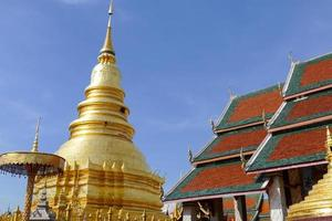 architecture of traditional buddhist temple and golden pagoda
