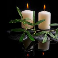 Beautiful spa setting of green tendril passionflower, candles photo
