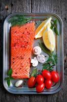 raw salmon fillet with cherry tomato, mushroom, dill, garlic