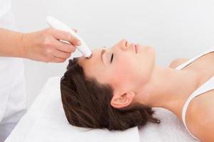 Woman Under Going Microdermabrasion Treatment photo