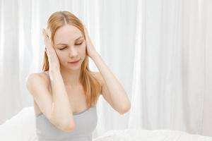 Caucasian woman closing the ears photo