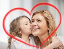 Caucasian mother and daughter expressing love