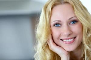 Caucasian woman with long hair looking at camera photo