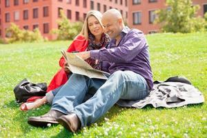 Middle aged caucasian couple reading a map