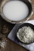 The bowl of fresh oat milk
