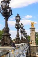 Young man in Paris on the bridge of Alexander III photo