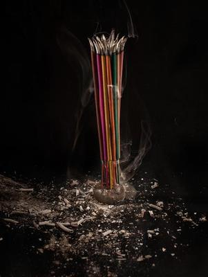 Burning Incense Sticks With Smoke And Ash On Black Background Stock Photo