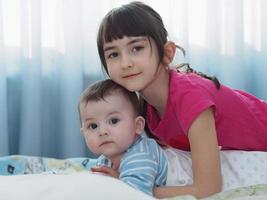 Portrait of caucasian children playing at home photo