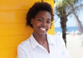 Laughing african american girl near beach photo
