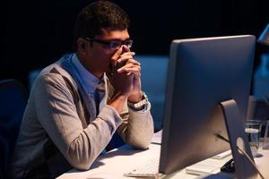 Stressed overworked businessman photo