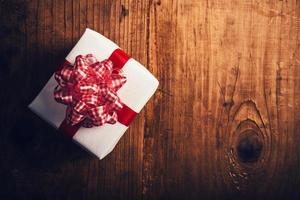 Gift box on wooden desk photo