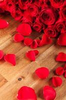 Bouquet of roses on wooden desk photo