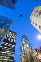 jet airplane silhouette with business office building towers background