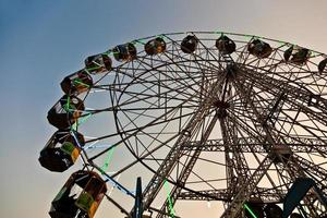 people enjoy the big wheel in the amusement park