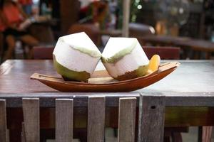 Chop off the tops and enjoy refreshing coconut water.