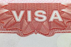 Foreign Visa in a passport  page  -  enjoy travel background