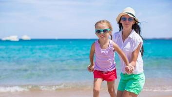 Beautiful mother and her adorable little daughter enjoy summer vacation photo